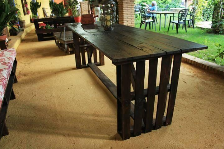recycled pallet dining table with cushioned bench