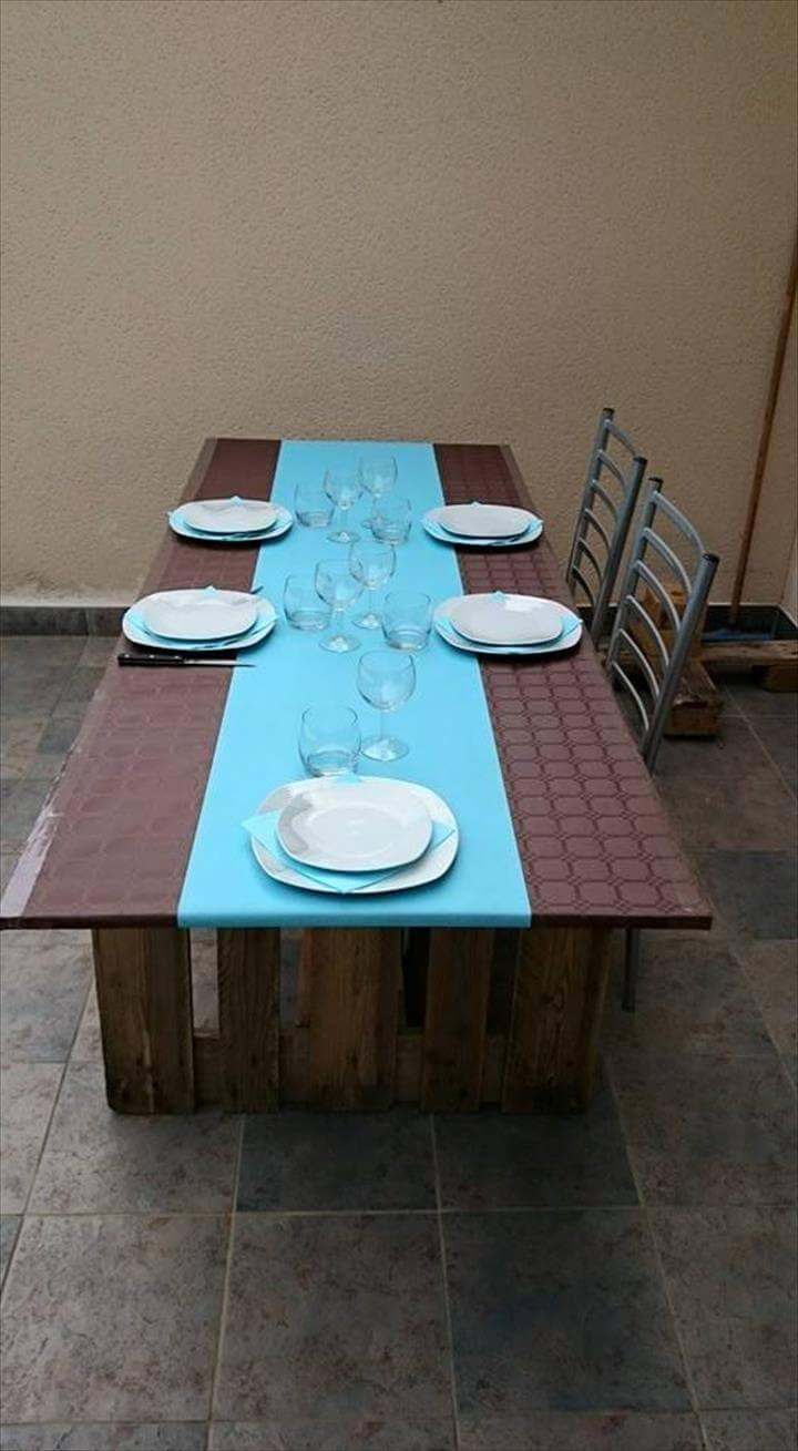 repurposed pallet dining table with MDF plate top