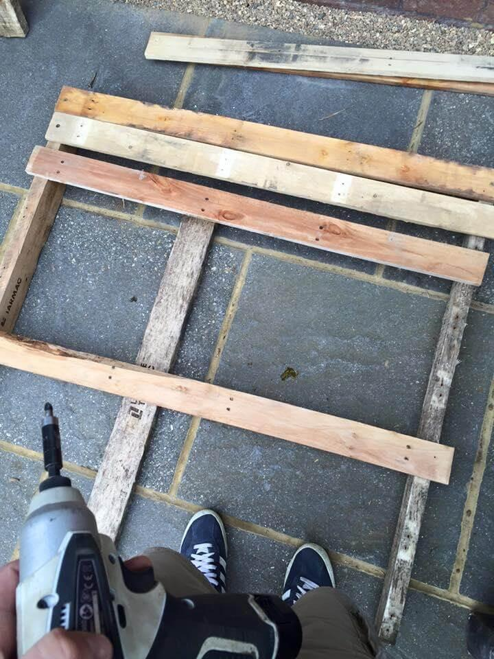 installing the removed pallet slats to build the different bench sections