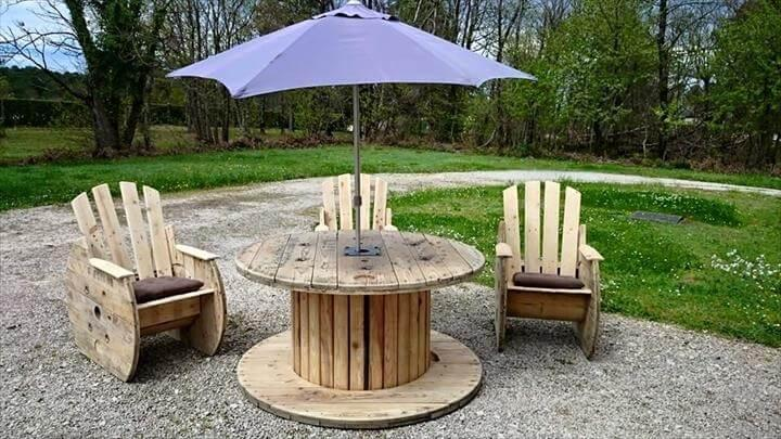 repurposed pallet and cable spool dining table with umbrella