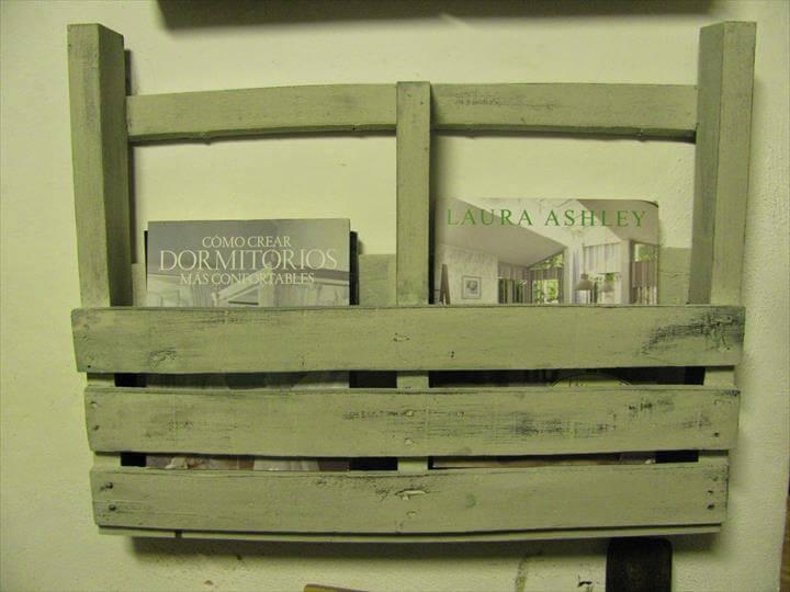 light green distressed wall magazine rack