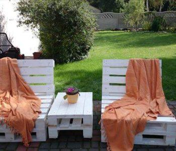 white loungers made of whole pallets