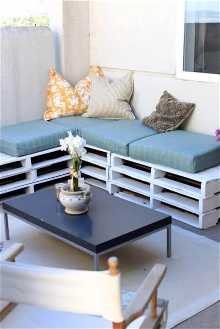 stacked pallet raised sofa with cushion