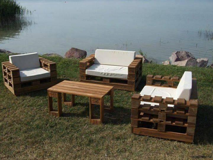 sturdy pallet sofa and chairs with white foam cushions