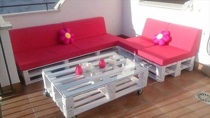 white pallet sofa with red cushion
