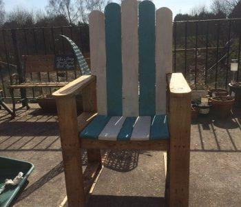 recycled pallet half painted Adirondack chair