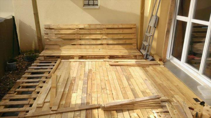 finishing the flooring by adding removed pallet slats