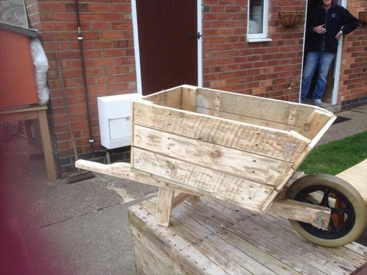 recycled pallet wheelbarrow planter