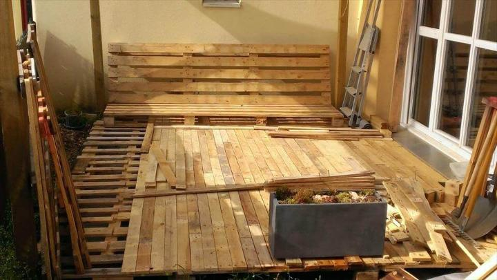 adding the 2nd layer of removed pallet slats