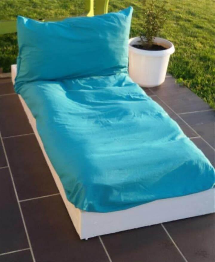 wooden pallet lounger with cushion