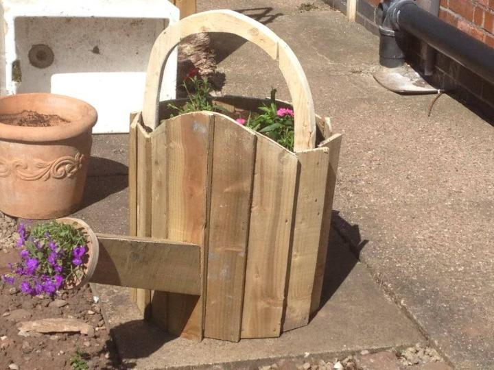 handcrafted pallet garden watering can planter