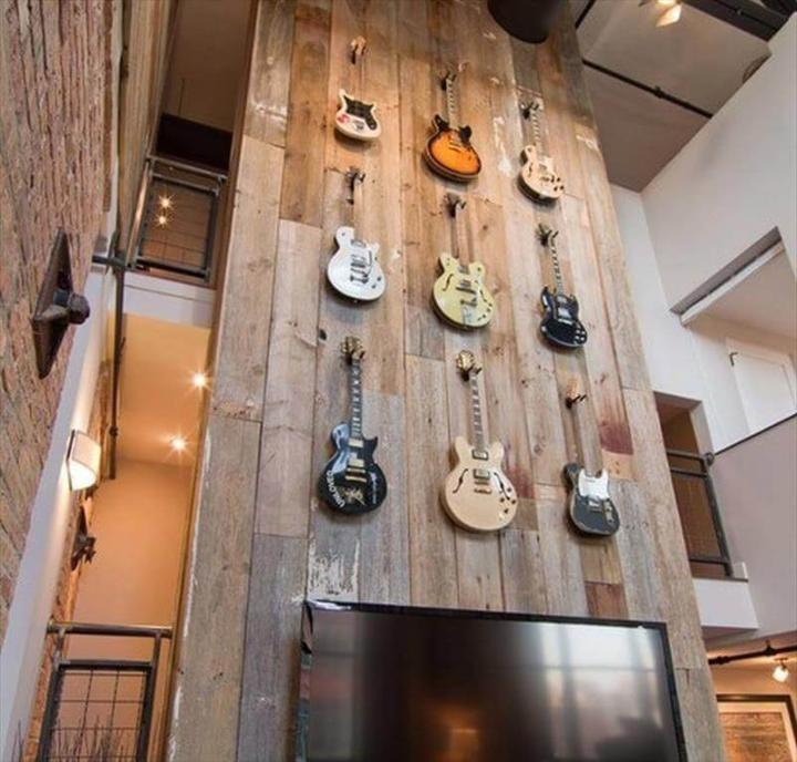 diy wood pallet paneled wall with guitar hang accent