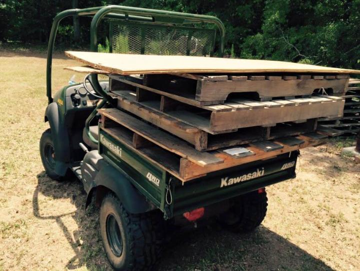 stock of pallets and a plywood sheet