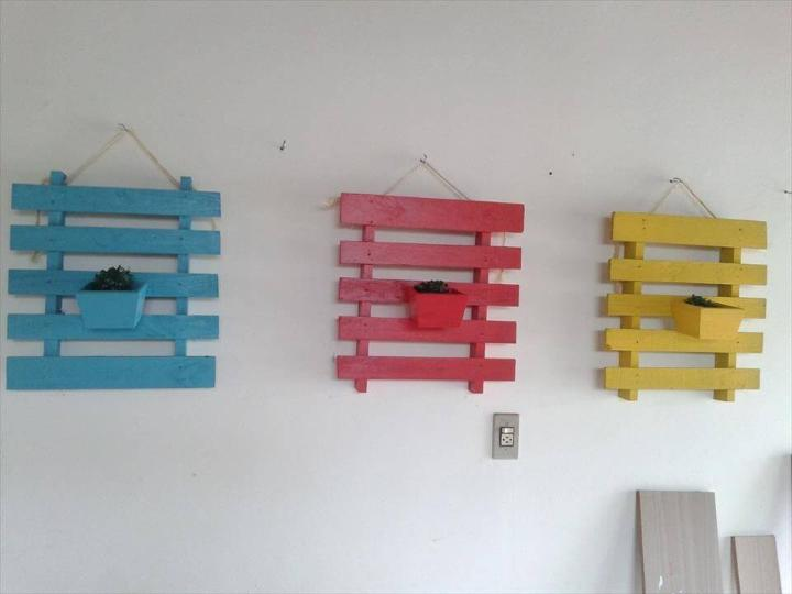 upcycled pallet painted wall hanging planters