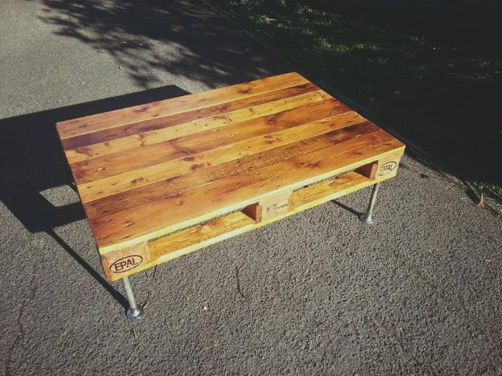 one pallet coffee table with metal pipe legs