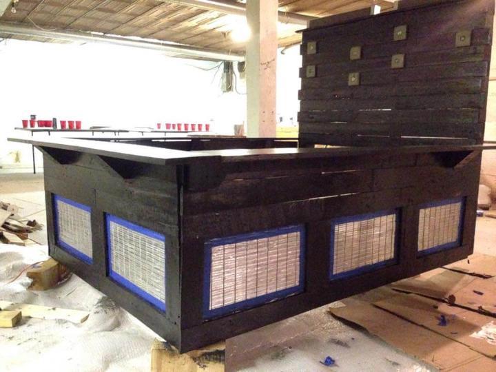 Repurposed pallet platform bed with headboard