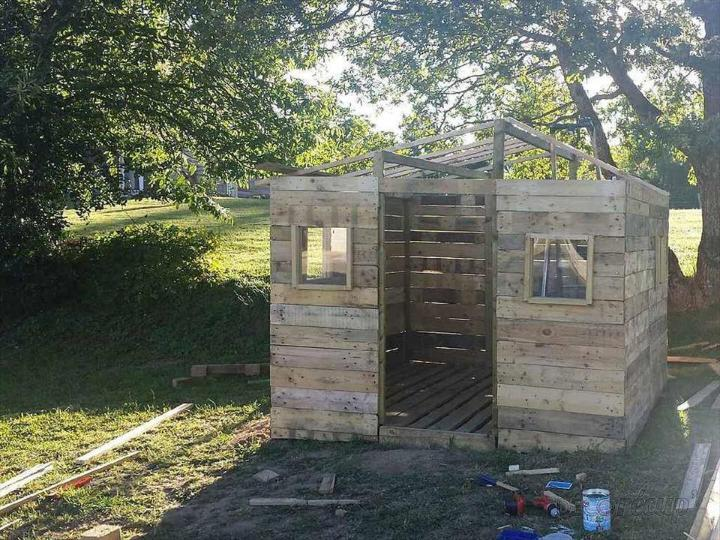 handmade wooden pallet tiny house installation