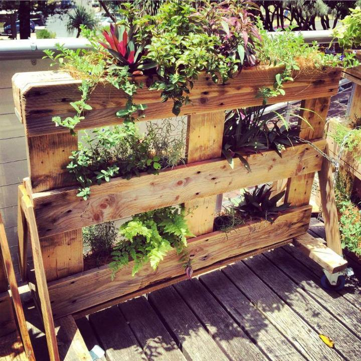 rustic wooden multitiered pallet planter with wheels