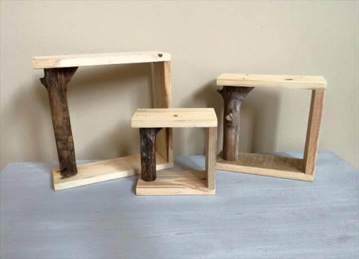 gorgeous pallet and tree branch shelves