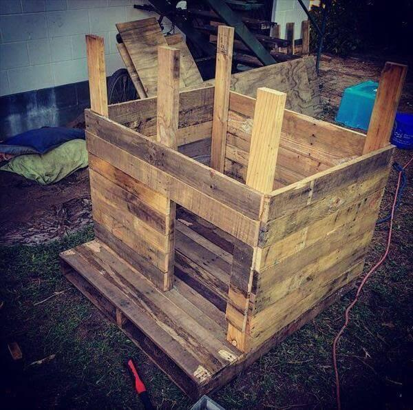handmade wooden pallet doghouse construction
