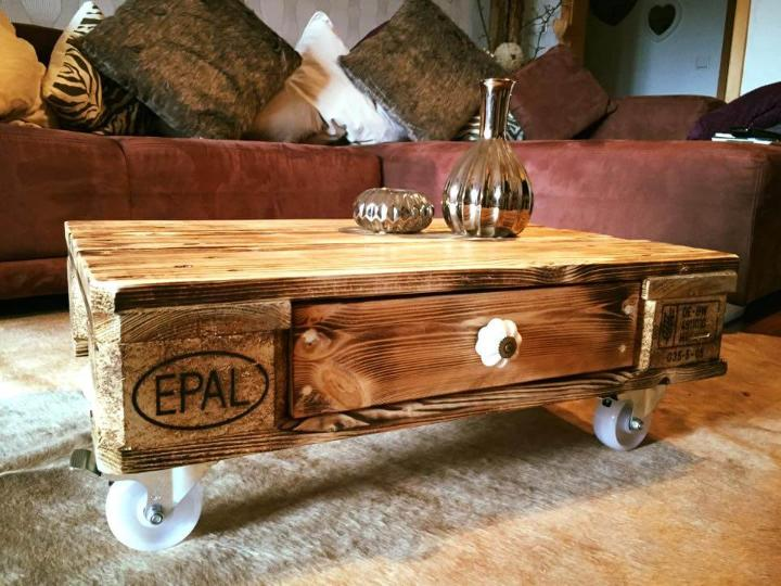 one pallet coffee table with one drawer and wheels