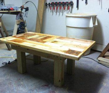upcycled wooden pallet coffee table with thicker wooden legs