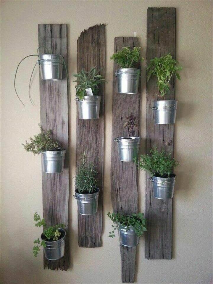 pallet and steel bucket wall hanging garden