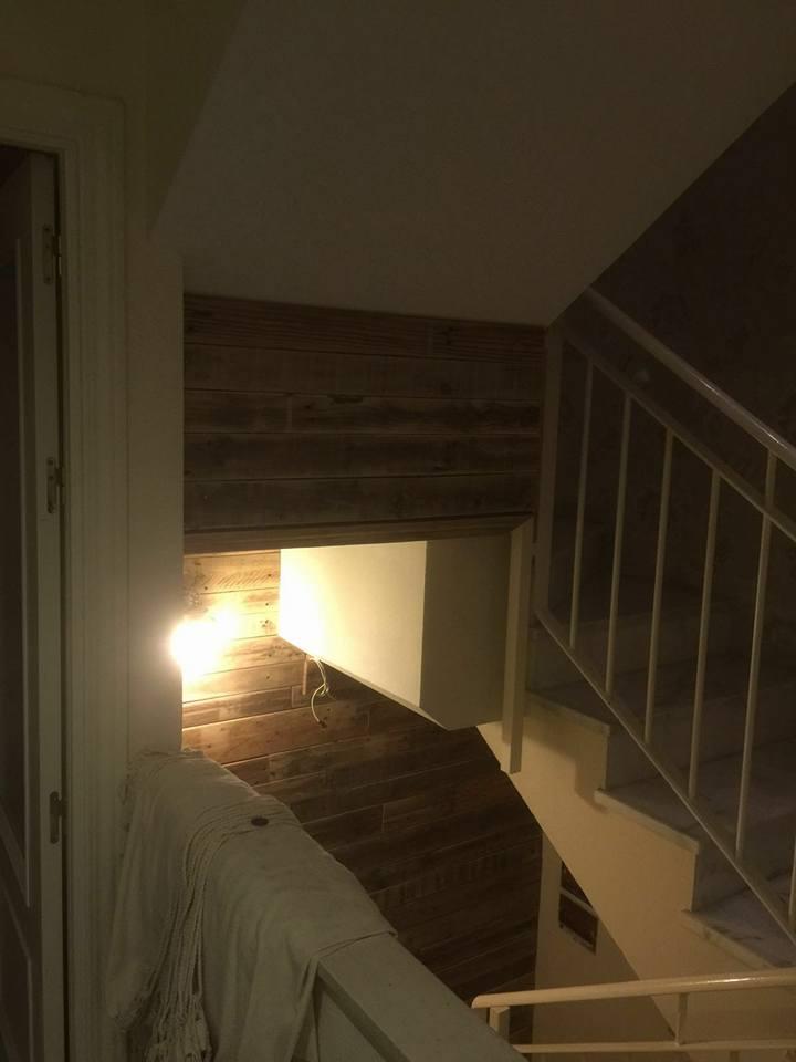 rustic wooden pallet stairway wall
