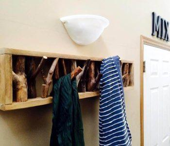 pallet and tree branch coat rack