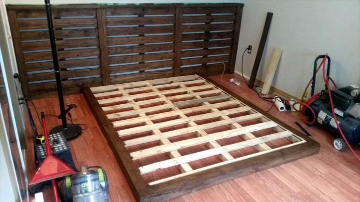 wooden pallet bed with custom headboard