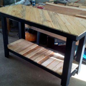 recycled pallet kitchen island with diagonal stripe patterned top