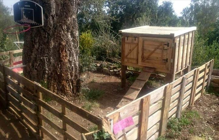 diy pallet chicken coop with wooden fence