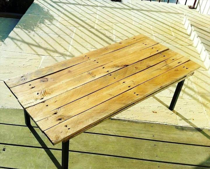 handmade wooden pallet coffee table with black painted wooden legs