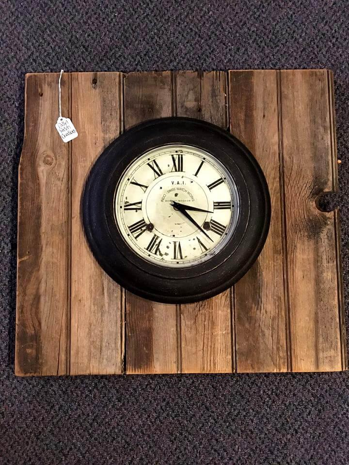 clock mounted on a wooden pallet board