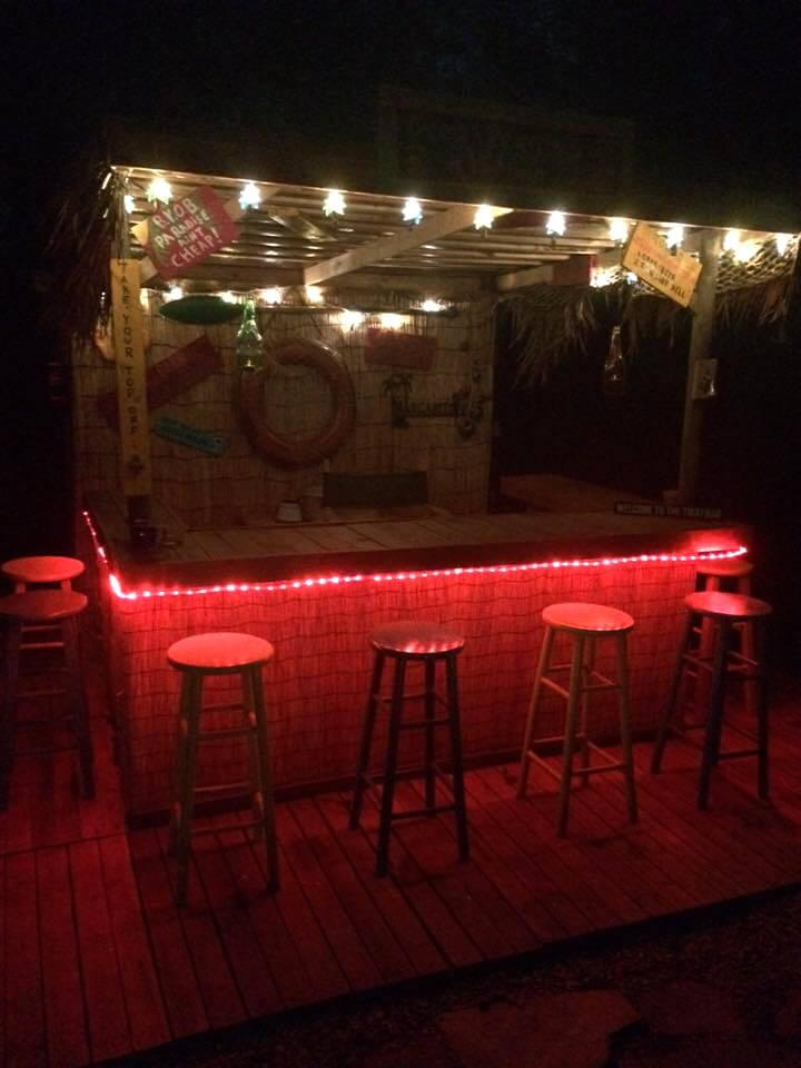 bar made of pallets and decorated with lights