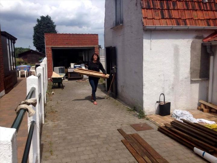 carrying the removed pallet slats for reconditioning and staining