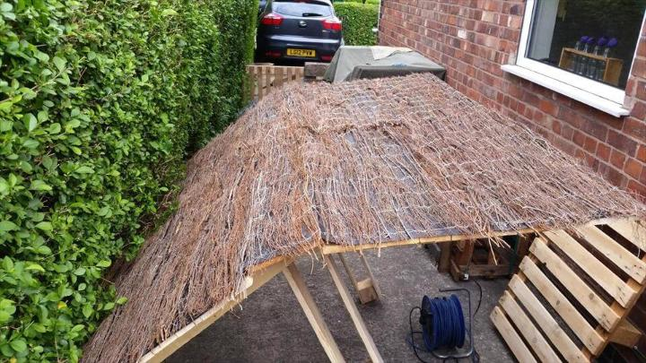 adding the straw sheet to bar roof for an antique touch
