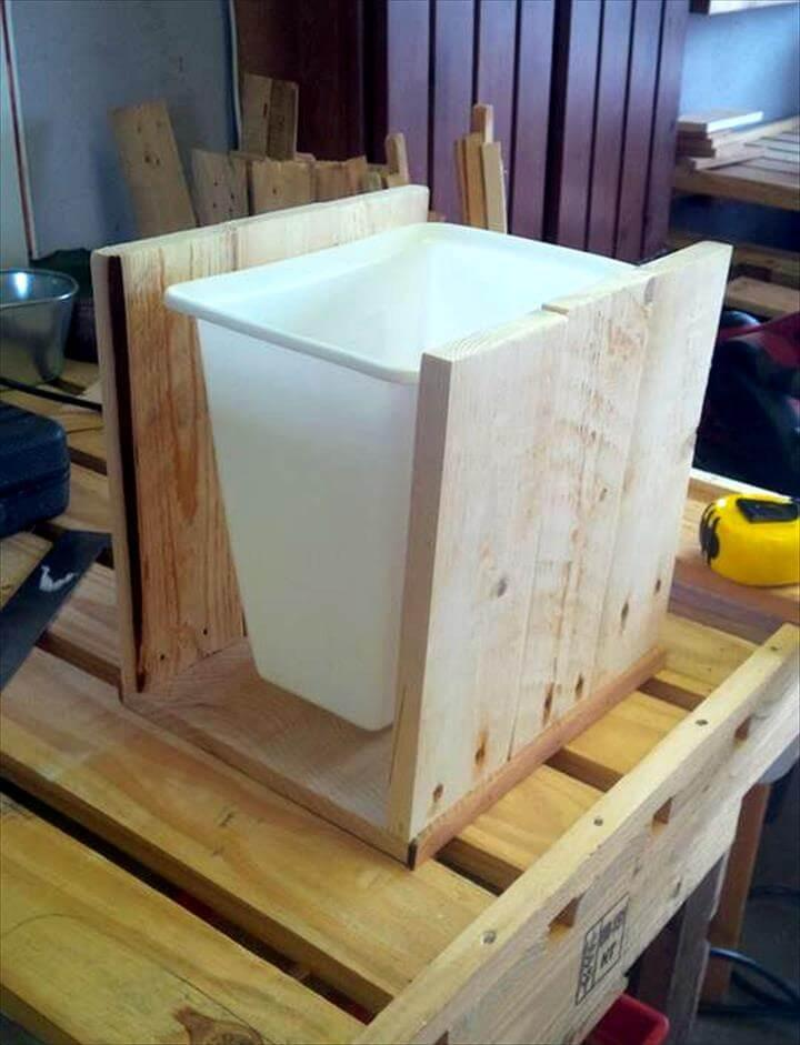 making the wooden holding for the plastic bin
