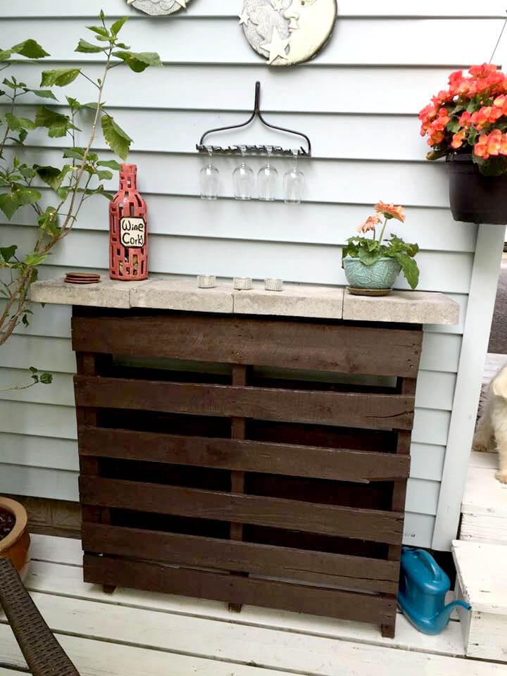 handcrafted wooden pallet bar with concrete counter
