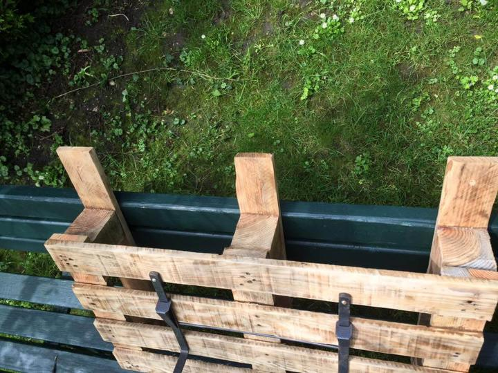 wooden pallet and metal planter holder