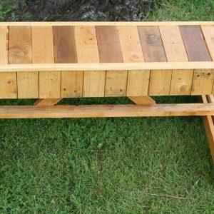 upcycled pallet bench with flat triangular legs