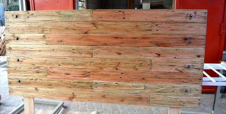 repurposed pallet headboard with iron rivets