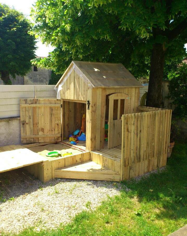 diy pallet kids playhouse with installed sandbox