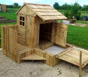budget-friendly pallet playhouse with installed sandbox