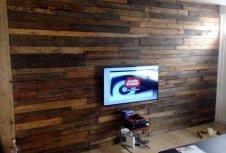 self-installed wood pallet media wall