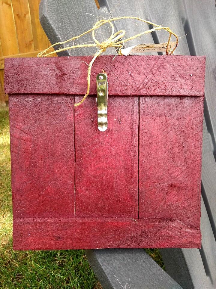 red stained pallet picture frame