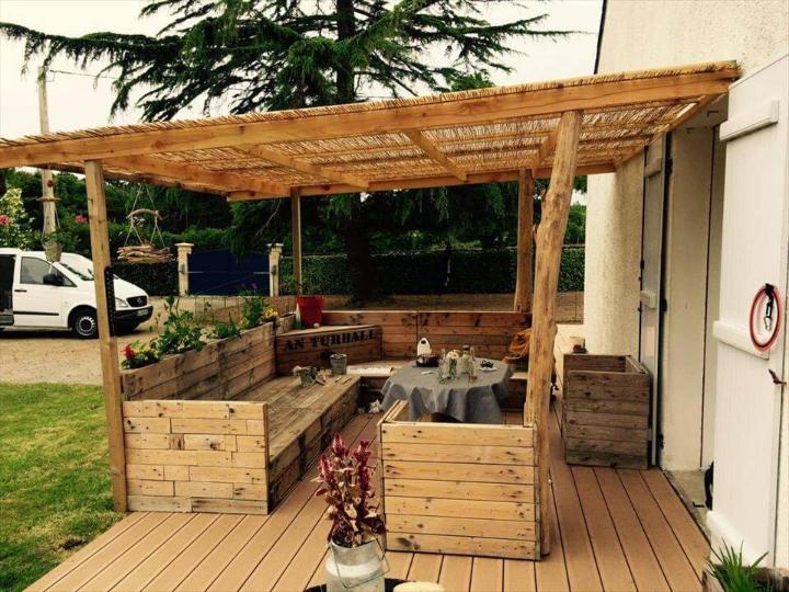 diy wooden deck done with pallets and old wood logs