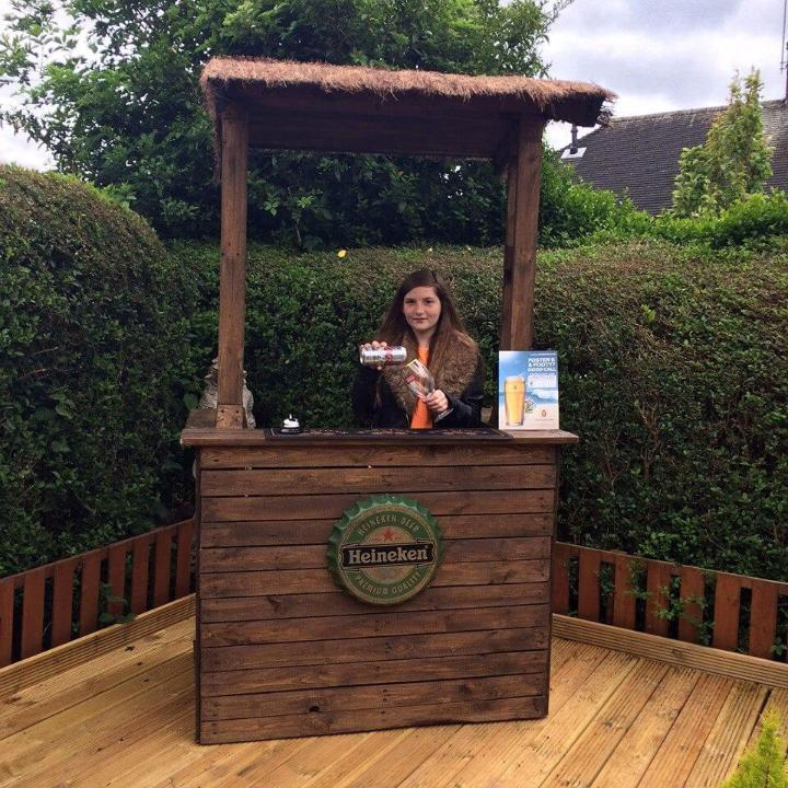 recycled pallet outdoor bar with shelter
