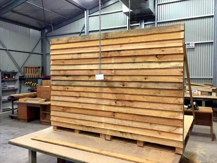 installing the walls of pallet playhouse