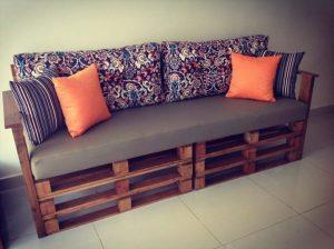 cushioned sofa out of stacked pallets